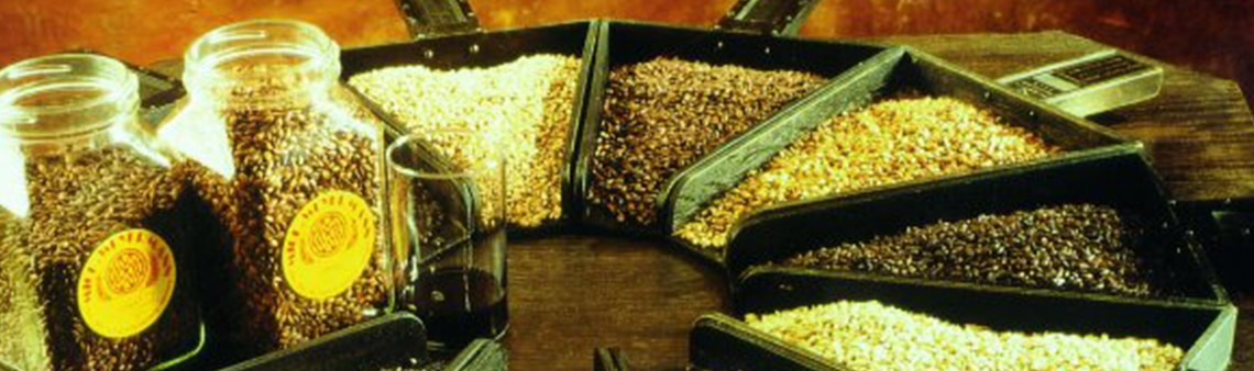 Photo of a range of Weyermann® malts in jars and small shovels